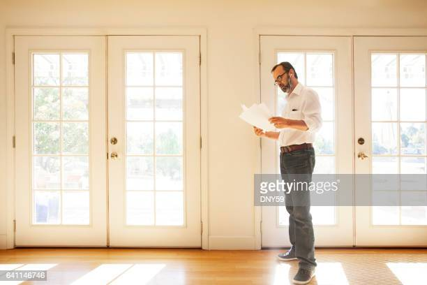 Hispanic Businessman Working From Home On His Mobile Phone