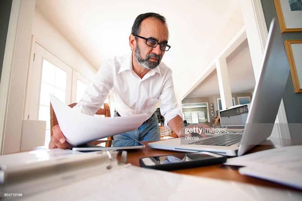 Hispanic Businessman Working From Home : Stock Photo