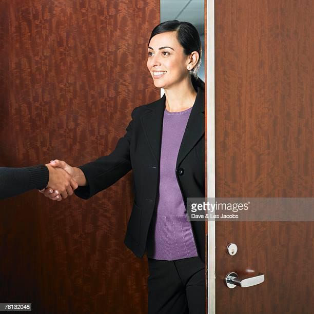 Hispanic businesswoman shaking hands