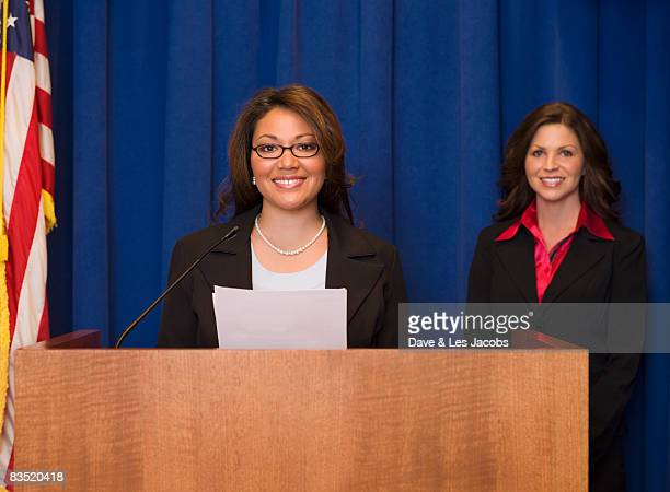 hispanic businesswoman speaking at podium - candidate stock pictures, royalty-free photos & images
