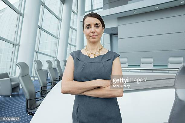Hispanic businesswoman standing in conference room