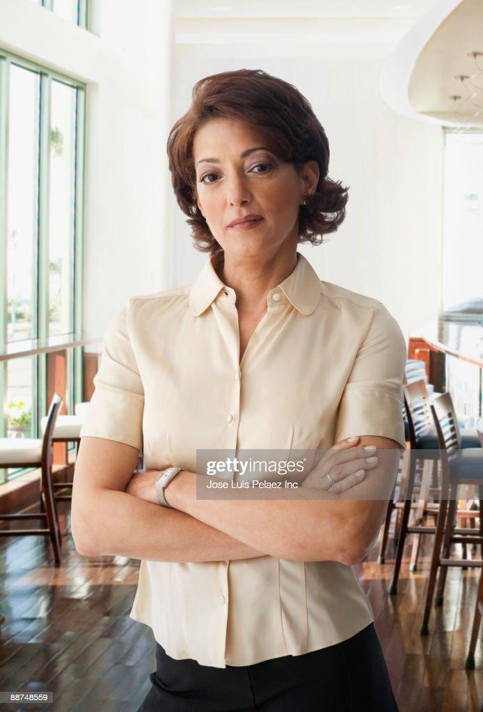 Hispanic businesswoman with arms crossed : Stock Photo