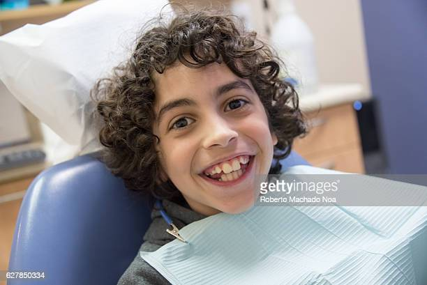 Hispanic child boy at the dentist office Pristine smile waiting to become a perfect smile