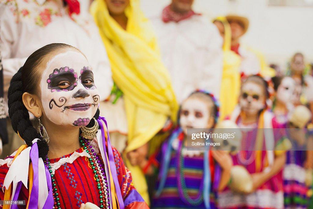Hispanic children celebrating Dia de los Muertos