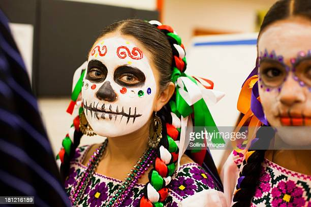 Hispanic children celebrating Dia de los Muertos