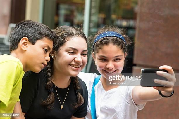 Hispanic children taking a selfie