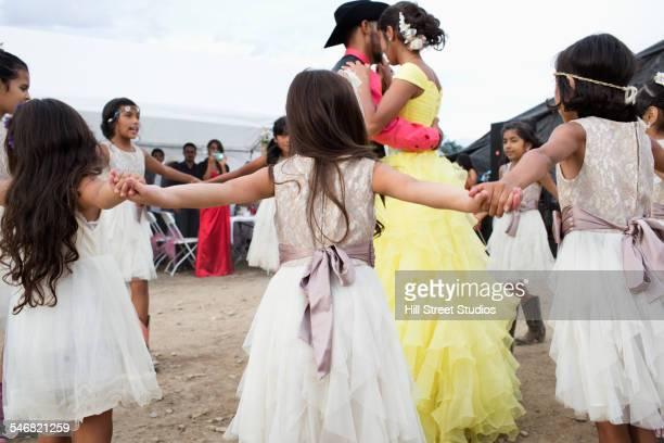 Hispanic community dancing at quinceanera