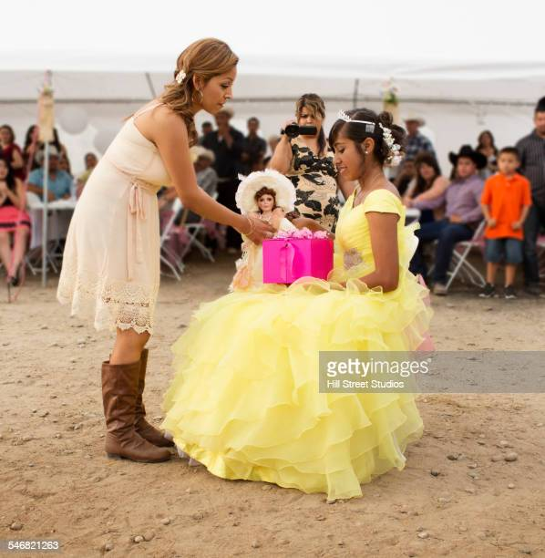hispanic community giving gifts at quinceanera - quinceanera stock pictures, royalty-free photos & images