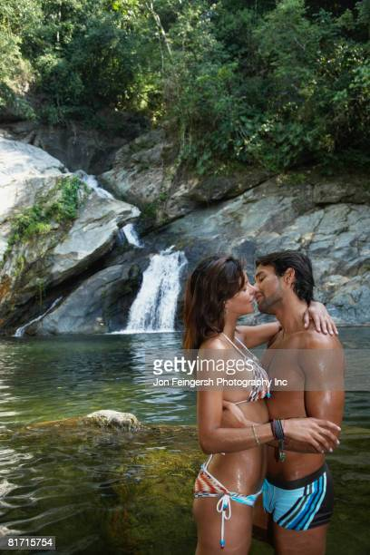 hispanic couple about to kiss - kissing on the mouth stock photos and pictures