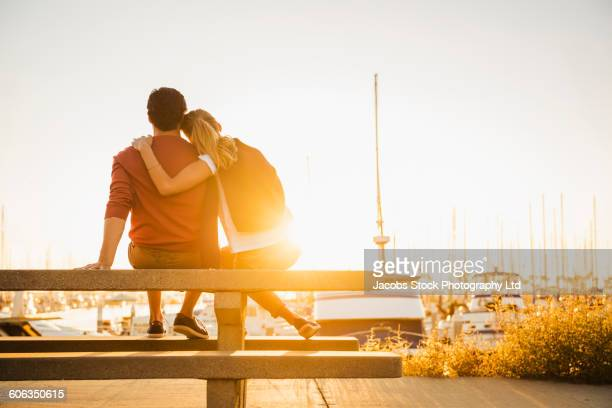 Hispanic couple admiring marina