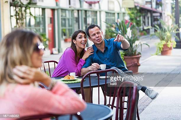 Hispanic couple at sidewalk cafe