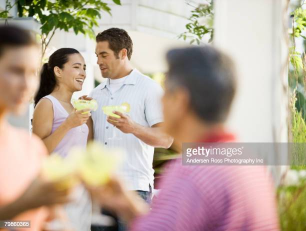 hispanic couple drinking cocktails - margarita drink stock photos and pictures