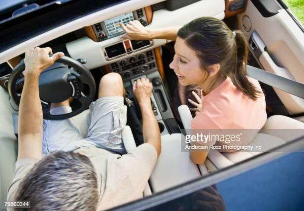 Hispanic couple driving in car