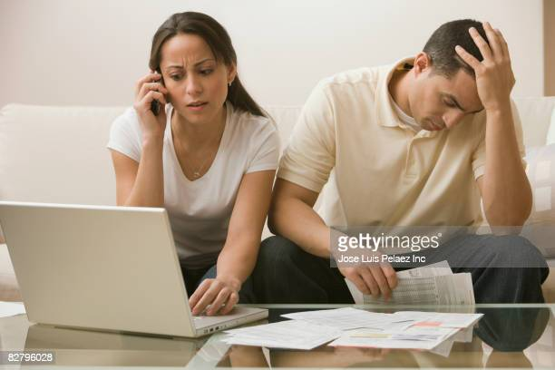 hispanic couple having difficulty paying bills online - struggle stock pictures, royalty-free photos & images