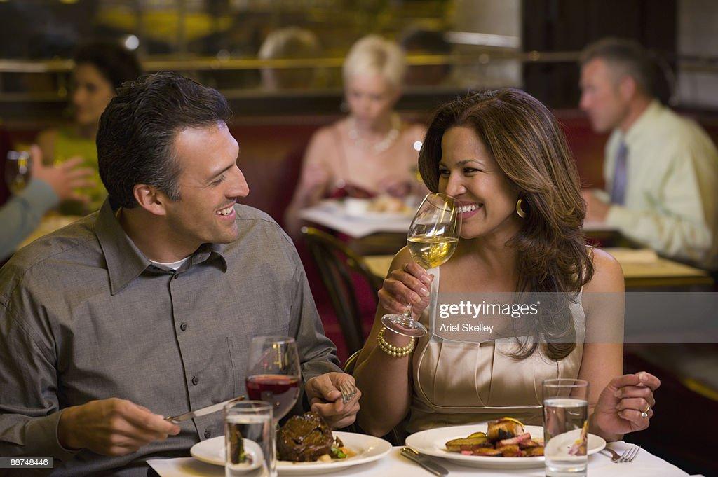 Hispanic couple having elegant dinner in restaurant : Stock Photo