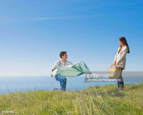 Hispanic couple having picnic