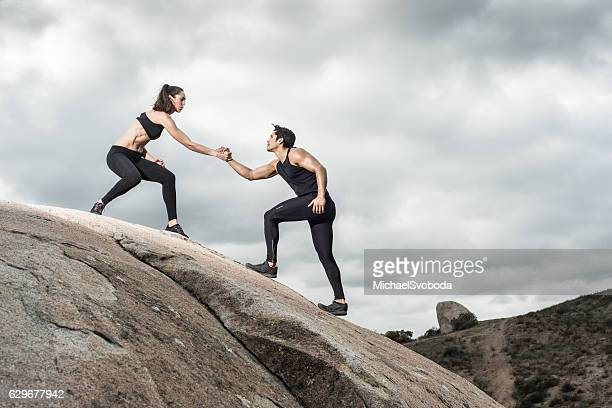 Hispanic Couple Helping Hands