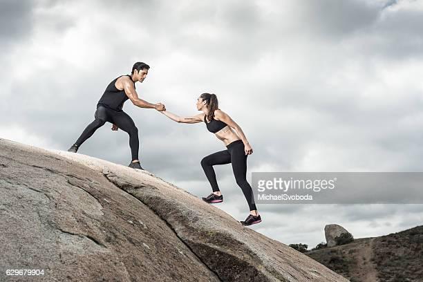 Hispanic Couple Helping Hands