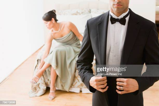 hispanic couple in evening wear - evening gown stock pictures, royalty-free photos & images
