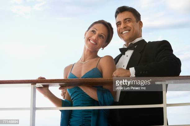 hispanic couple in eveningwear on ship - evening wear stock pictures, royalty-free photos & images