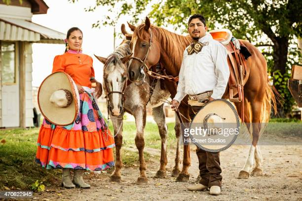 Hispanic couple in traditional clothing outdoors