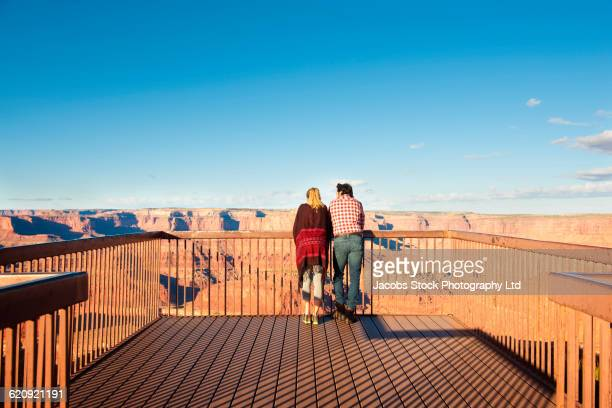 Hispanic couple looking at view from patio