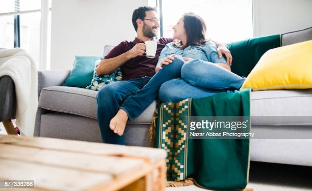 Hispanic couple relaxing at home.