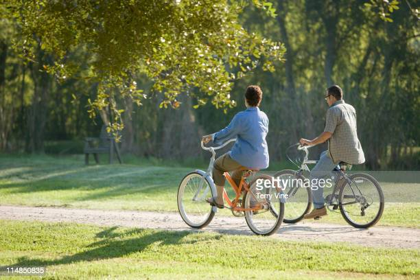 Hispanic couple riding bicycles