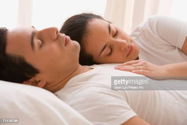 Hispanic couple sleeping