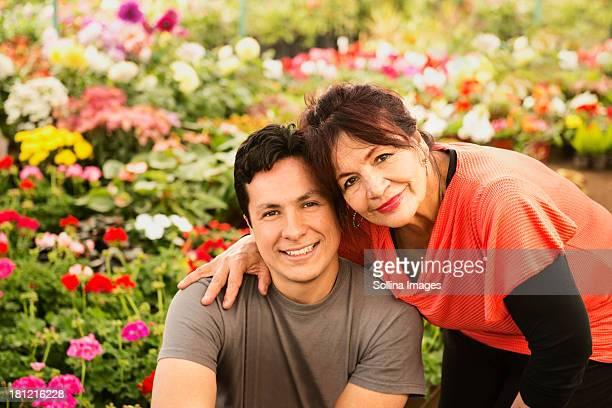 Hispanic couple smiling in field