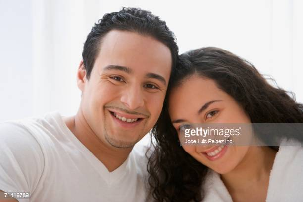 hispanic couple smiling - lebanese ethnicity stock photos and pictures