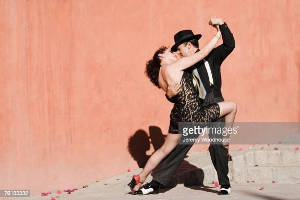 hispanic couple tango dancing - tango dance stock photos and pictures