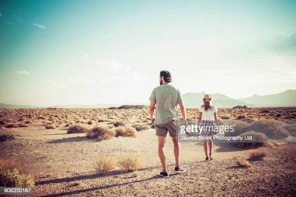 Hispanic couple walking in desert