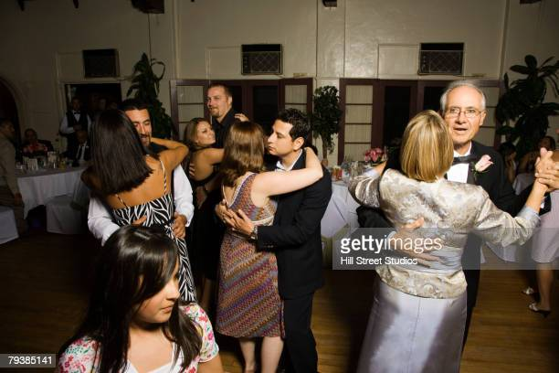 hispanic couples dancing at wedding - wedding guest stock pictures, royalty-free photos & images