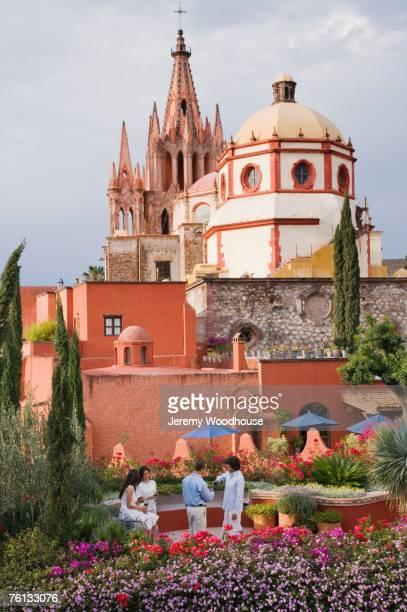 hispanic couples with cathedral in background - san miguel de allende fotografías e imágenes de stock