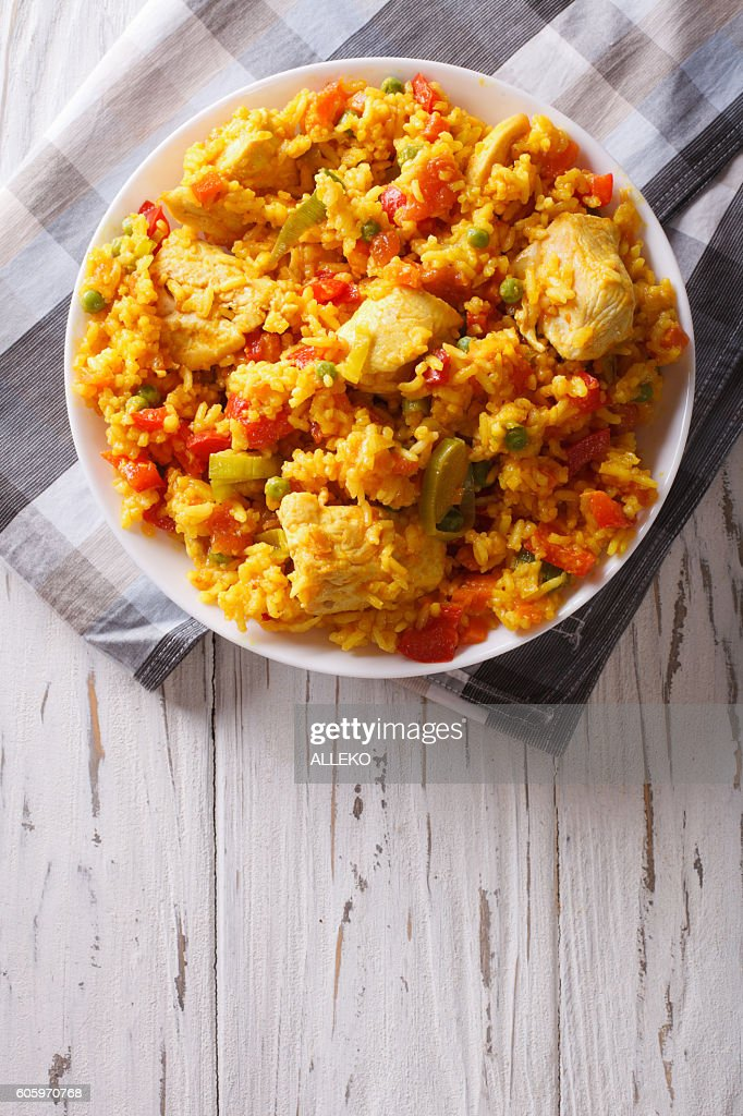Hispanic cuisine: Arroz con pollo closeup in a bowl. vertical : Stock Photo