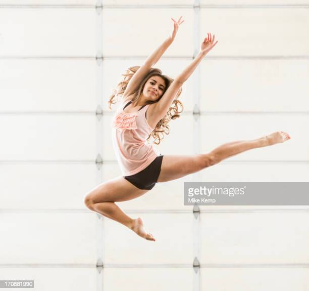 Hispanic dancer practicing in studio