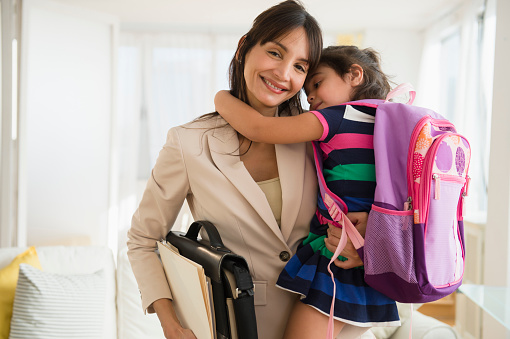 Hispanic daughter hugging mother as she leaves for work - gettyimageskorea