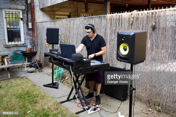 hispanic dj playing music in backyard - club dj stock pictures, royalty-free photos & images