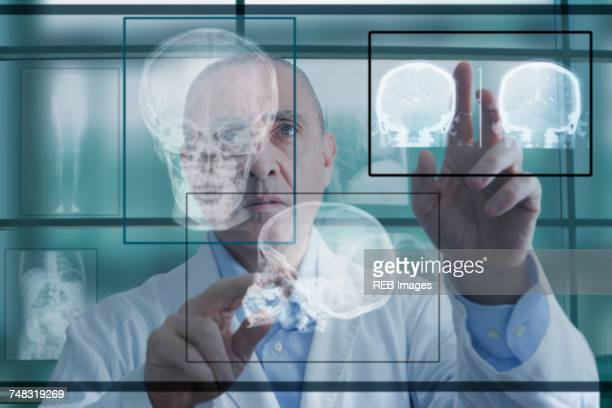 Hispanic doctor using virtual computer screen