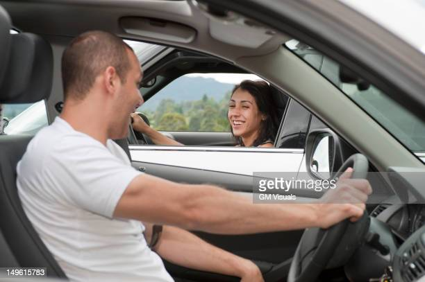 Hispanic drivers stopping to talk