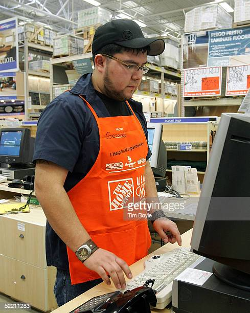 Hispanic employee Gerardo Hernandez works in The Home Depot store February 17 2005 in Evanston Illinois The world's largest home improvement retailer...