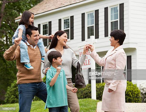 Hispanic family and realtor celebrating home sale