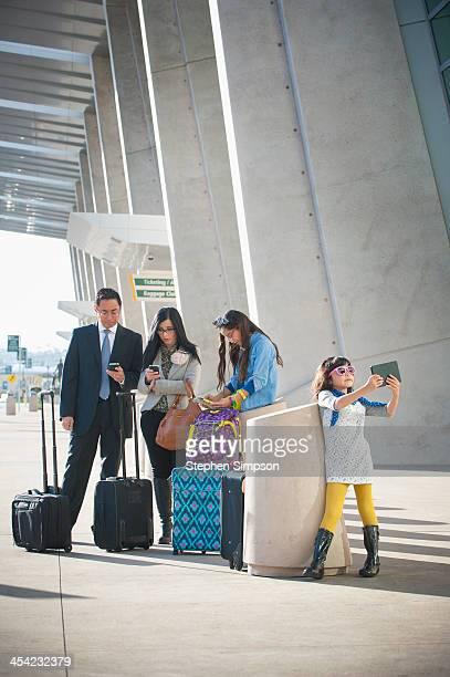 Hispanic family at airport between flights