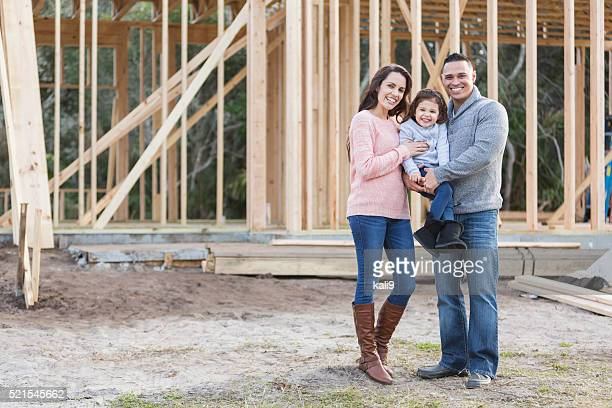 Hispanic family building a new home