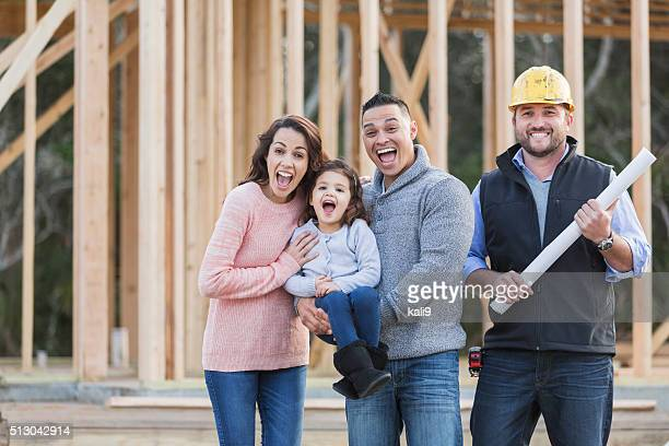 Hispanic family building a new home, with contractor