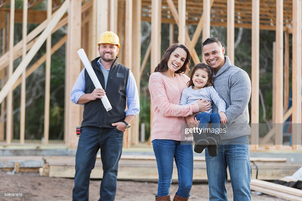 Hispanic family building a new home, with contractor : Stock Photo