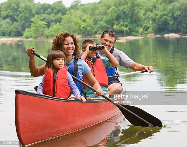 hispanic family canoeing - canoeing stock pictures, royalty-free photos & images