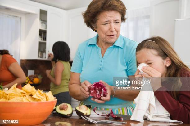 hispanic family cooking in kitchen - filipino family dinner stock pictures, royalty-free photos & images