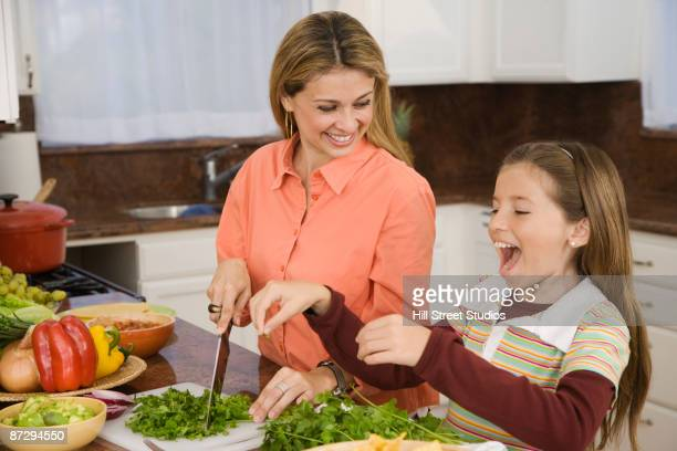 Hispanic family cooking in kitchen